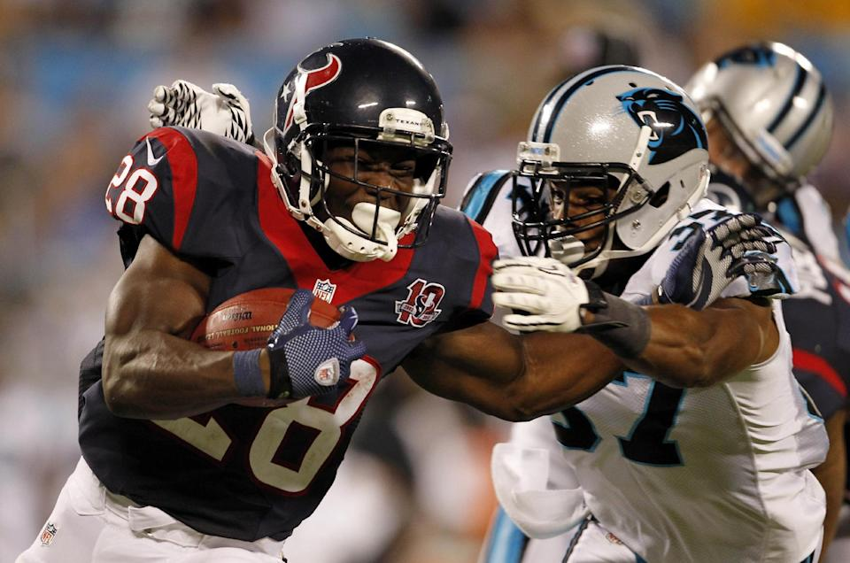 Carolina Panthers' Jonathan Nelson, right, reaches for Houston Texans' Justin Forsett (28) during the second half of an NFL preseason football game in Charlotte, N.C., Saturday, Aug. 11, 2012. (AP Photo/Bob Leverone)
