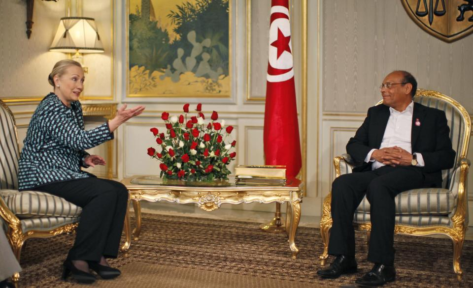 U.S. Secretary of State Hillary Rodham Clinton, left, meets with Tunisia's President Moncef Marzouk, center, at the Presidential Palace in Carthage, Tunisia, Saturday Feb. 25, 2012. (AP Photo/Jason Reed, Pool)