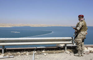 A peshmerga fighter stands guard at Mosul Dam in northern …