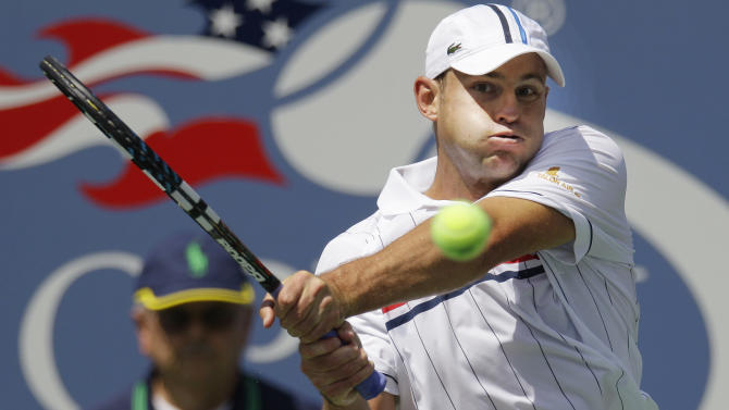 Andy Roddick returns a shot to Rhyne Williams in the first round of play at the 2012 US Open tennis tournament, Tuesday, Aug. 28, 2012, in New York. (AP Photo/Kathy Willens)