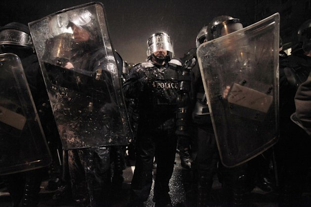 Riot police form up after clashes with demonstrators after  a protest against high electricity prices in Sofia, on late Tuesday, Feb. 19, 2013.  Bulgaria's prime minister announced on Tuesday that the