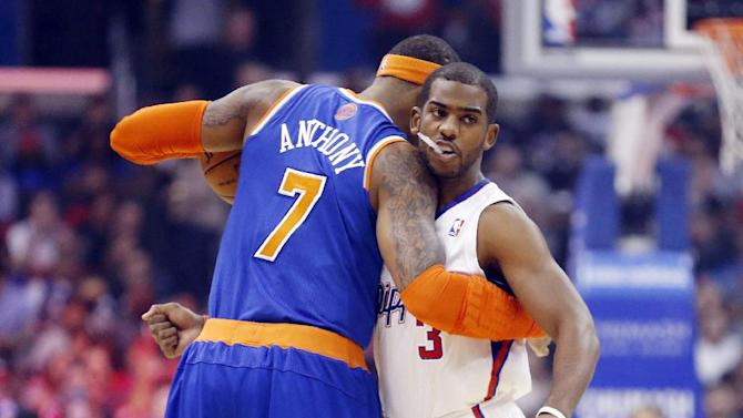 New York Knicks' Carmelo Anthony, left, and Los Angeles Clippers' Chris Paul, right, embrace before an NBA basketball game in Los Angeles, Wednesday, Nov. 27, 2013
