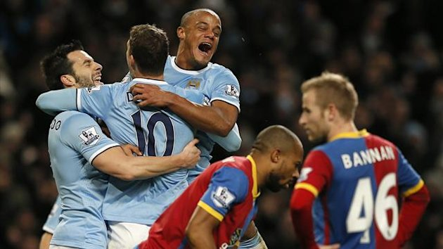 Manchester City celebrate Edin Dzeko's goal against Crystal Palace (Reuters)