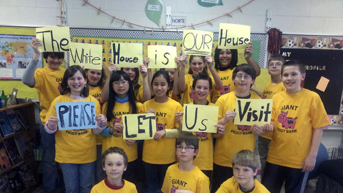 "6th grade students at St. Paul's Lutheran School in Waverly, Iowa, pose for a photo on March 6, 2013. The class had their upcoming visit canceled as the White House suspended all tours under across-the-board government spending cuts in a partisan budget battle. The disappointed class put a video on Facebook asking for the tour to be reinstated. ""The White House is our house, please let us visit,"" the children say in unison. (AP Photo/St. Paul's Lutheran School, Karen Thalacker)"