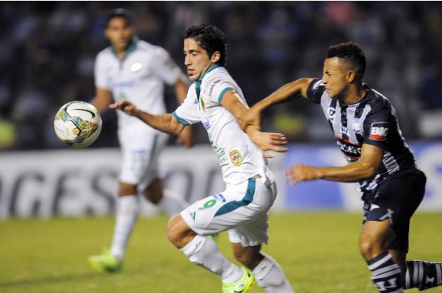 Mexico's Leon FC Brito fights for the ball with Ecuador's CS Emelec Quinonez during their second leg soccer match of the Copa Libertadores in Guayaquil