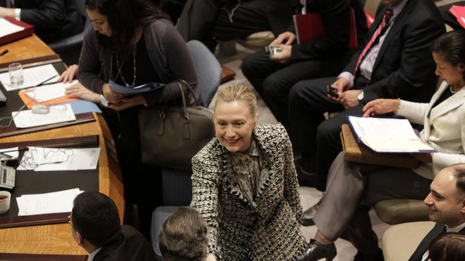 United States Secretary of State Hillary Rodham Clinton greets diplomats at a  Security Council meeting on the situation in the Middle East at United Nations Headquarters, Monday, March 12, 2012.  (AP Photo/Seth Wenig)