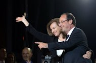France's Socialist Party (PS) newly elected president Francois Hollande celebrates with companion Valerie Trierweiler at the Place de la Bastille in Paris after the announcement of the first official results of the French presidential second round