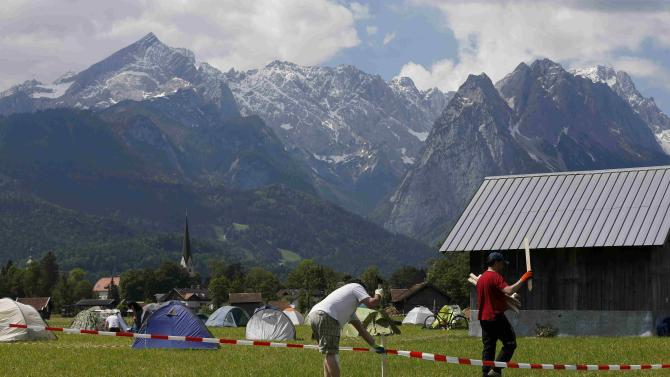 G7 opponents set up a tent camp on the field near the Loisach river in the outskirts of Garmisch-Partenkirchen