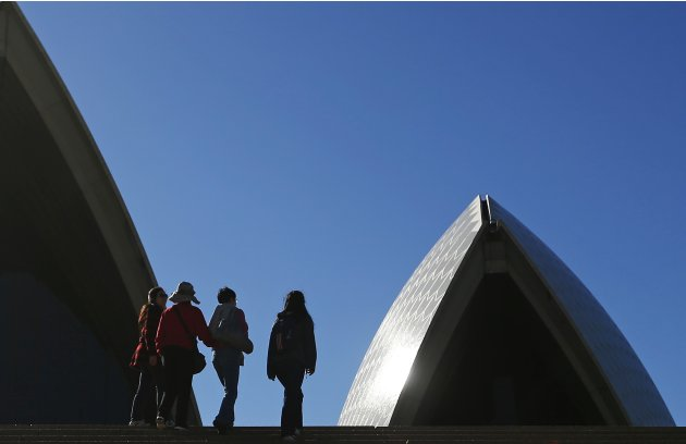 Chinese tourists walk on the steps of the Sydney Opera House in central Sydney