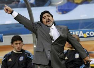 Argentina's coach Maradona gestures during their 2010 World Cup quarter-final soccer match against Germany at Green Point stadium in Cape Town
