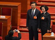 The outgoing Chinese Foreign Minister Yang Jiechi (left) poses for a photo during the 12th National People's Congress (NPC) in the Great Hall of the People in Beijing, on March 16, 2013