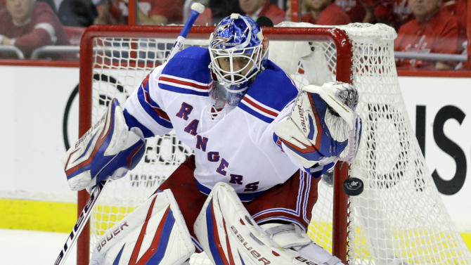 New York Rangers goalie Henrik Lundqvist (30), from Sweden, keeps his eye on the puck in the first period of Game 5 first-round NHL Stanley Cup playoff hockey series against the Washington Capitals, Friday, May 10, 2013, in Washington. (AP Photo/Alex Brandon)