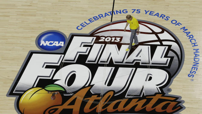 Michigan head coach John Beilein walks on the floor during practice the NCAA Final Four tournament college basketball semifinal game against Syracuse, Friday, April 5, 2013, in Atlanta. Michigan plays Syracuse in a semifinal game on Saturday. (AP Photo/David J. Phillip)