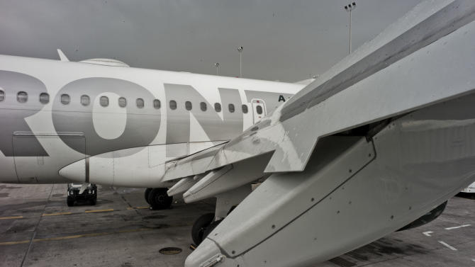In this photo provided by Frontier Airlines,  a wing of a Frontier Airlines plane shows dents from a hail storm in Denver on Thursday, July 14, 2011. More than 100 flights were canceled at Denver International Airport after hail damaged about 40 planes and stranded about 1,000 passengers overnight. Airport spokeswoman Laura Coale said Thursday that all damaged planes had to be evaluated, slowing operations. She says an unknown number of planes have been taken out of service because of damage.  (AP Photo/Frontier Airlines)