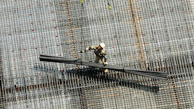 A man works at a construction site in Tokyo