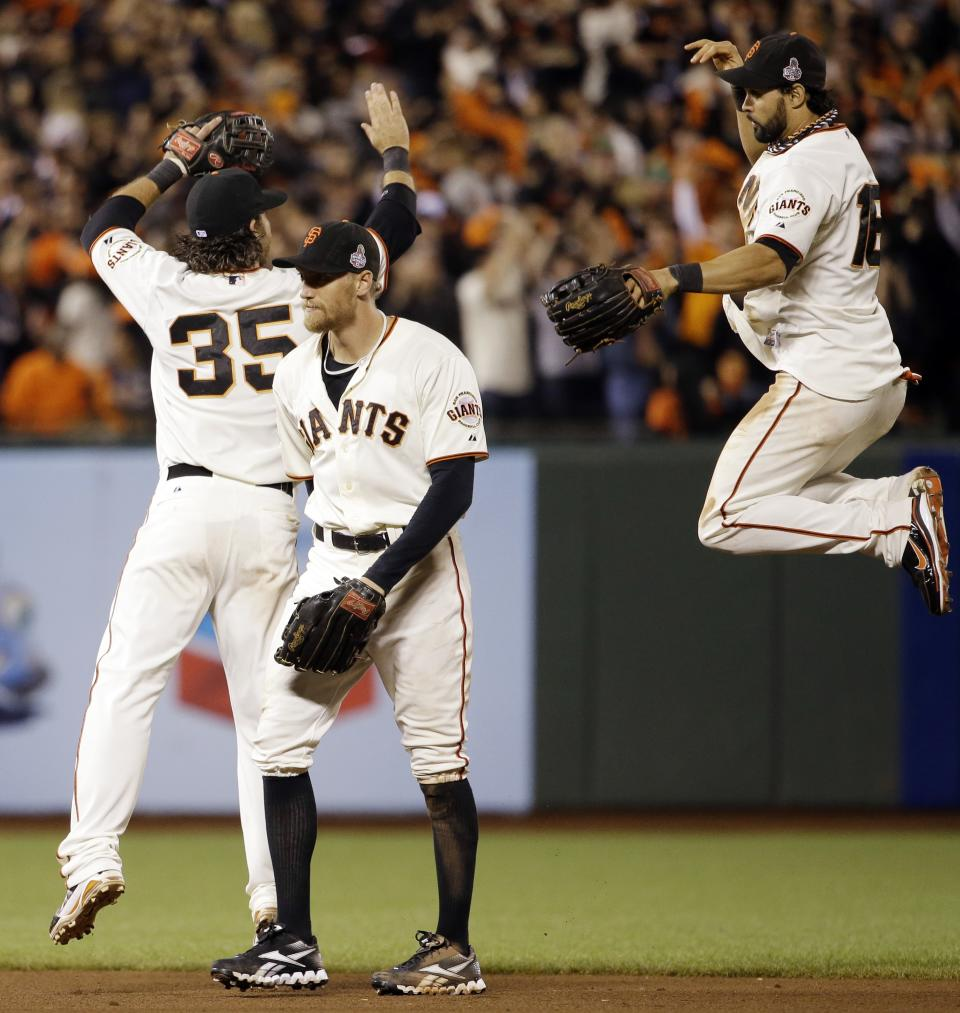 San Francisco Giants' Angel Pagan leaps up to celebrate with Brandon Crawford and Hunter Penc after the Giants beat the Detroit Tigers 2-0 in Game 2 of baseball's World Series Thursday, Oct. 25, 2012, in San Francisco. (AP Photo/David J. Phillip)