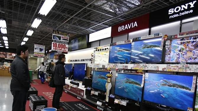 Shoppers look at Sony Corp's Bravia televisions at an electronics retail store in Tokyo February 5, 2014. REUTERS/Yuya Shino