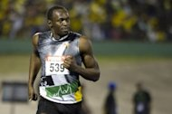 Sprinter Usain Bolt in the 100m semi-final of the Jamaican Olympic AthleticTrials at the National Stadium in Kingston, June 29, 2012. A man screamed abuse at Bolt before throwing a plastic beer bottle on to the track just before the men's 100 metres final at the London Olympics