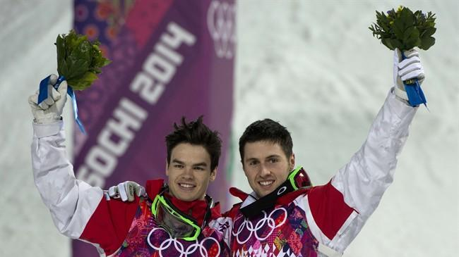 Canadians Alex Bilodeau, gold medallist, right, and silver medallist Mikael Kingbury celebrate their win following the men's moguls finals at the Sochi Winter Olympics in Krasnaya Polyana, Russia, Monday, Feb. 10, 2014. THE CANADIAN PRESS/Jonathan Hayward