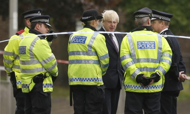 Mayor of London, Boris Johnson, speaks to police officers near the scene of the killing of a British soldier in Woolwich, southeast London