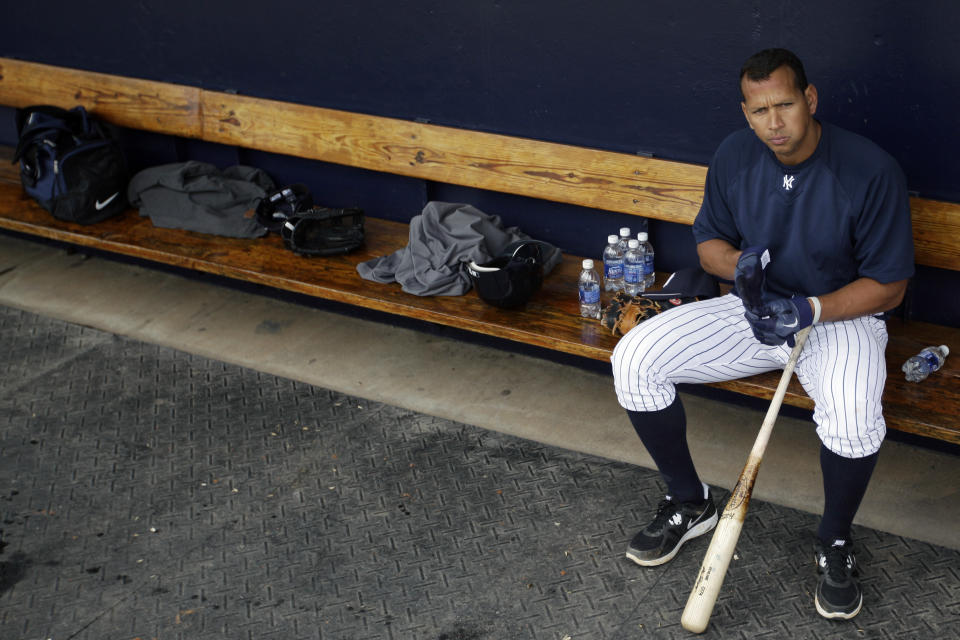 New York Yankees' Alex Rodriguez sits in the dugout during practice at baseball spring training, Saturday, Feb. 25, 2012, in Tampa, Fla. (AP Photo/Matt Slocum)