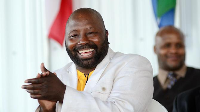 "Mark ""Too Sharp"" Johnson laughs during the International Boxing Hall of Fame induction ceremony in Canastota, N.Y., Sunday, June 10, 2012. Johnson is one of six living inductees in this year's class. (AP Photo/Heather Ainsworth)"