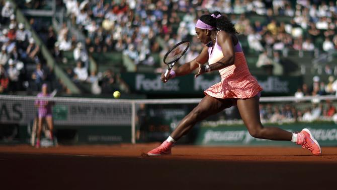 Serena Williams of the U.S. plays a shot to Victoria Azarenka of Bulgaria during their women's singles match at the French Open tennis tournament at the Roland Garros stadium in Paris