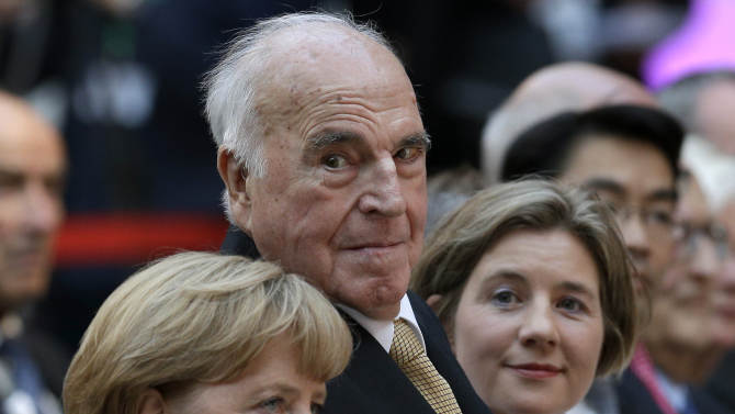 German Chancellor Angela Merkel, former German Chancellor Helmut Kohl and Kohl's wife Maike Kohl-Richter, from left, attend a reception of the Konrad-Adenauer-Foundation-Foundation in Berlin, Germany, Thursday, Sept. 27, 2012. With the reception the Konrad-Adenauer-Foundation will celebrate the 30th anniversary of the start of Kohl's chancellorship on Oct. 1, 1982. (AP Photo/Michael Sohn)