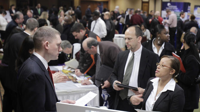In this May 3, 2011 photo, Justin Miller, left, talks with Leah Chanthapanya, right, at a job fair, in Independence, Ohio. Chanthapanya is looking for a customer service or administrative position. Employers added more than 200,000 jobs in April for the third straight month, the biggest hiring spree in five years. But the unemployment rate rose to 9 percent in part because some people resumed looking for work. (AP Photo/Tony Dejak)