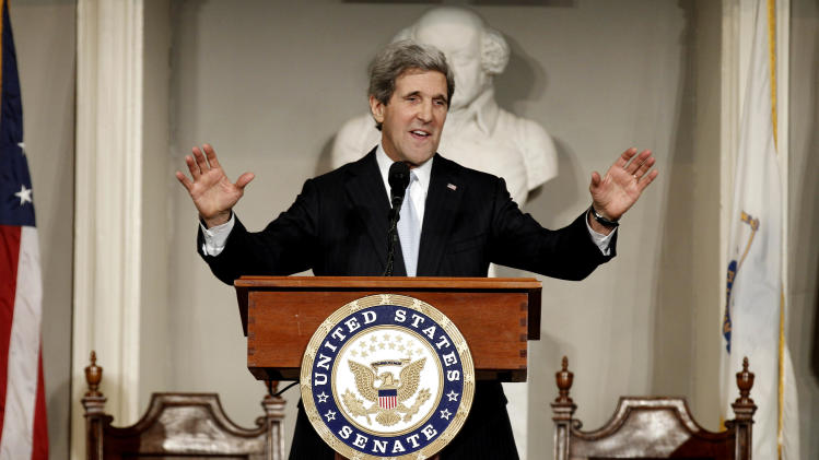 U.S. Sen. John Kerry acknowledges applause while addressing constituents at Faneuil Hall in Boston Thursday, Jan. 31, 2013. Kerry will step down tomorrow from the office he has held for nearly three decades to become the next secretary of state. (AP Photo/Winslow Townson)