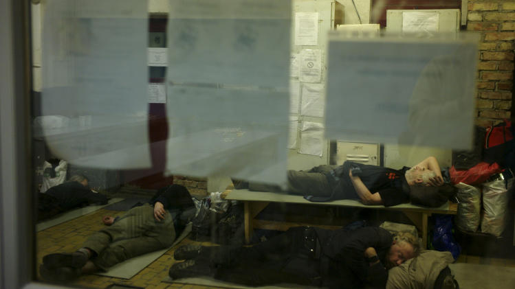 In this photo taken early morning Friday, Jan. 11, 2013, homeless sleep on the floor in a shelter called 'The Heated Street' in Budapest, Hungary. Hungary considers constitutional change to allow authorities to force homeless off the streets. (AP Photo/Bela Szandelszky)