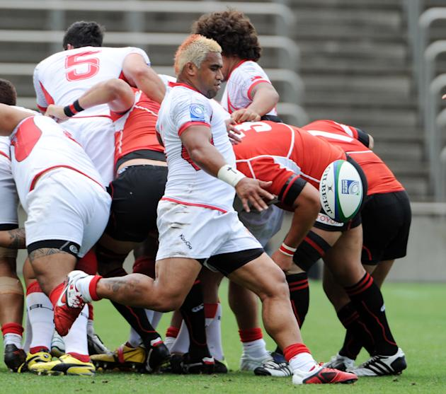 Tonga's scrum-half Taniela Moa kicks the