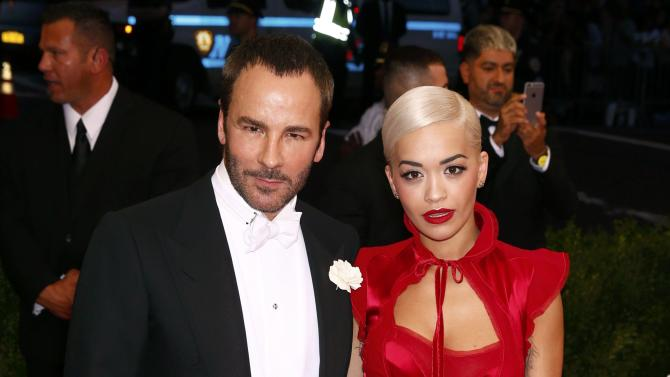 "Singer Rita Ora and fashion designer Tom Ford arrive at the Metropolitan Museum of Art Costume Institute Gala 2015 celebrating the opening of ""China: Through the Looking Glass,"" in Manhattan"