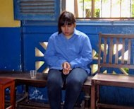 Thai national Preeyanooch Phuttharaksa, 23, sits waiting for her verdict at a local court in Ho Chi Minh City. A court in Vietnam sentenced the Thai design student to death for trafficking three kilos (6.6 pounds) of synthetic drugs into Vietnam, media reports said