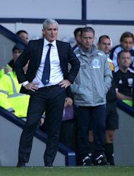 Mark Bowen, right, defended former QPR manager Mark Hughes, left