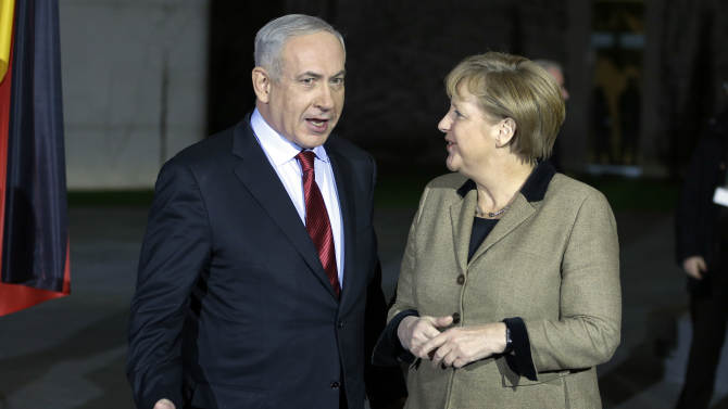 German Chancellor Angela Merkel, right, welcomes the Prime Minister of Israel, Benjamin Netanjahu, in front of the chancellery in Berlin, Germany, Wednesday, Dec. 5, 2012 for a joint dinner prior to intergovernmental talks on Thursday. (AP Photo/Michael Sohn, pool)
