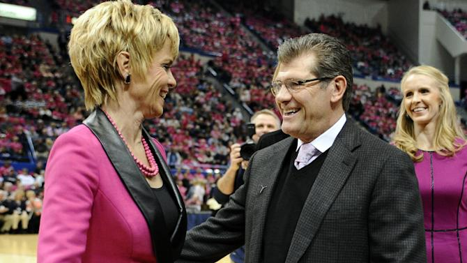 Baylor head coach Kim Mulkey, left, and Connecticut head coach Geno Auriemma, greet one another before an NCAA college basketball game between the two teams in Hartford, Conn., Monday, Feb. 18, 2013. (AP Photo/Jessica Hill)