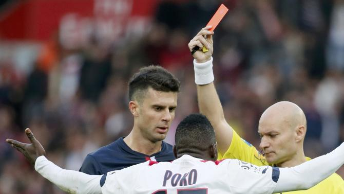 Girondins Bordeaux's Poko gets a red card from referee Chapron during their French Ligue 1 soccer match against Paris St Germain at the Parc des Princes stadium in Paris