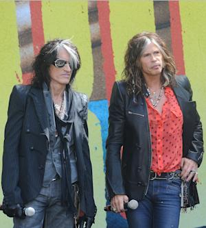 FILE - This March 28, 2012 file photo shows Joe Perry, left, and Steven Tyler from the band Aerosmith at a news conference announcing their 2012 Global Warming Tour at The Grove in Los Angeles. The Global Warming Tour will begin on June 16,  in Minneapolis. (AP Photo/Katy Winn, file)