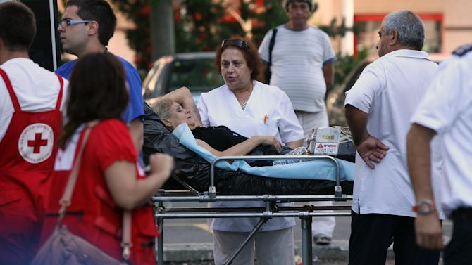 An unidentified injured Israeli tourist is helped as she leaves a hospital in the city of Burgas, Bulgaria, Thursday, July 19, 2012. A daytime bombing that killed eight people and injured dozens on a bus full of Israeli tourists was most likely a suicide attack, Bulgaria's interior minister said Thursday. He said the suspected attacker was carrying a Michigan driver's license that was being sent to the FBI for authentication. (AP Photo/Impact Press Group)