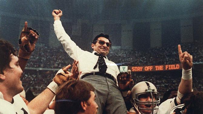 FILE - In this Jan. 2, 1983 file photo, Penn State football coach Joe Paterno celebrates as he is carried off the field after a 27-23 victory against Georgia in the Sugar Bowl,  to claim the national championship, at the Superdome in New Orleans. Paterno say he plans to retire at the end of the season, his long and illustrious career brought down because he failed to do all he could about an allegation of child sex abuse against a former assistant.  (AP Photo/File)