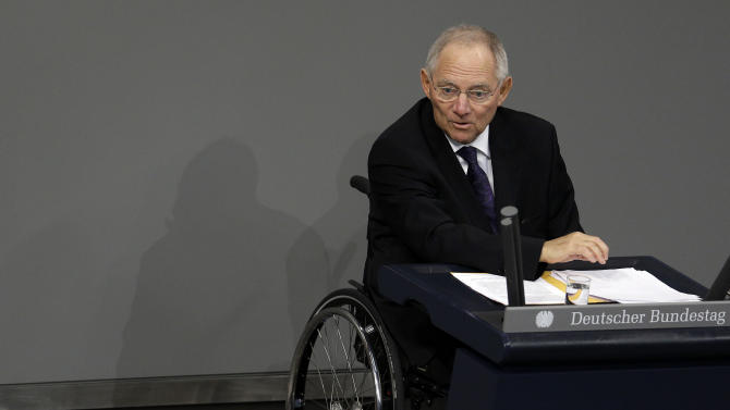 German Finance Minister Wolfgang Schaeuble gestures during his speech as part of a meeting of the German federal parliament, Bundestag, in Berlin, Germany, Friday, Nov. 30, 2012. (AP Photo/Michael Sohn)