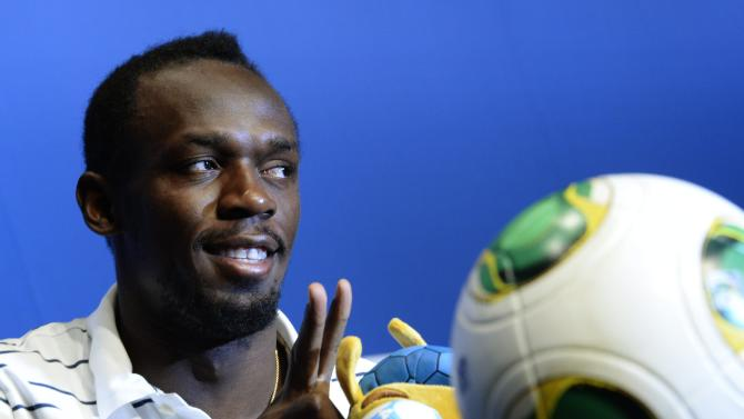 Jamaican sprint star Usain Bolt speaks at a press conference on Wednesday, Aug. 28, 2013, at the FIFA headquarters in Zurich, Switzerland, in the run-up to the IAAF Diamond League meeting in Zurich tomorrow Thursday. (AP Photo/Keystone, Steffen Schmidt)