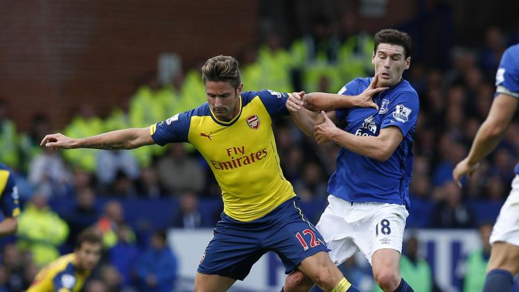 Everton's Barry challenges Arsenal's Giroud during their English Premier League soccer match at Goodison Park in Liverpool