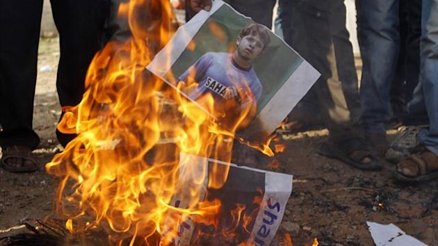 Demonstrators burn a poster of former India Test bowler Shanthakumaran Sreesanth during a protest (Reuters)