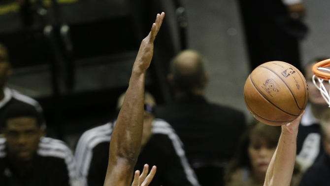 San Antonio Spurs' Manu Ginobili (20), of Argentina, attempts a shot as Miami Heat's Chris Bosh (1) defends during the second half at Game 5 of the NBA Finals basketball series, Sunday, June 16, 2013, in San Antonio. (AP Photo/David J. Phillip)