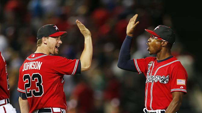 Freeman, Santana help Braves win 8th straight
