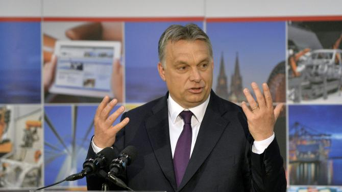 Hungarian Prime Minister Viktor Orban addresses the annual meeting of the German-Hungarian Chamber of Commerce and Industry in the Budapest Business School in Budapest, Hungary, Thursday, May 7, 2015. ( Zoltan Mathe/MTI via AP)