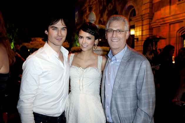 "Ian Somerhalder and Nina Dobrev of ""The Vampire Diaries"" with Mark Pedowitz (President, The CW Network) at The CW Fall Premiere party presented by Bing at Warner Bros. Studios on September 10, 2011 in"