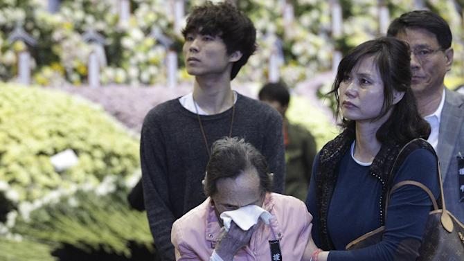 A woman cries as she pays tribute to the victims of the sunken ferry Sewol
